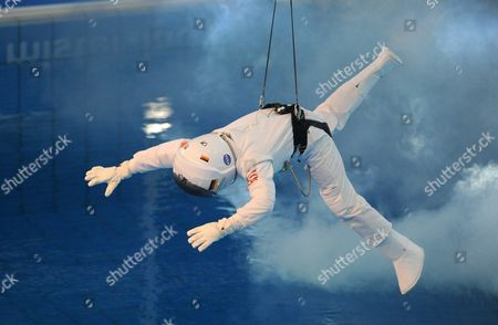 German Television Presenter Stefan Raab in a Spacesuit is Lowered From the Tower at the Start of the 'Tv Total Turmspringen' (tv Total Diving) Competition at the Olympia-schwimmhalle in Munich Germany 24 November 2012 Germany Munich