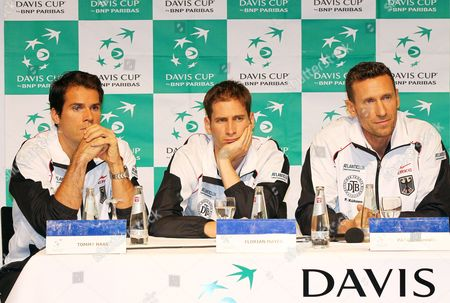 German Davis Cup Team Players (l-r)tommy Haas Philipp Petzschner and Team Coach Patrick Kuehnen Attend the Official Davis Cup Draw Ceremony in Bamberg Germany 09 February 2012 Germany Will Face Argentina in the Davis Cup World Group First Round Germany Bamberg