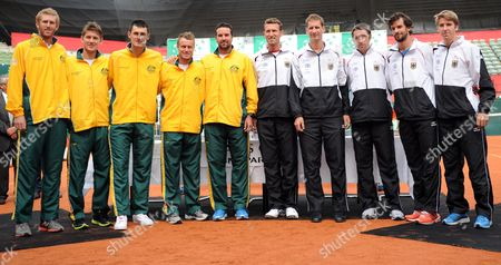 Stock Photo of The Australian Tennis Team with Chris Guccione (l-r) Matthew Ebden Bernard Tomic Lleyton Hewitt and Coach Patrick Rafter and the German Tennis Team with Coach Patrik Kuehnen Florian Mayer Benjamin Becker Philipp Petzschner and Cedrik-marcel Stebe Pose For Pictures During the Drawe For the Davis Cup Matchups in Hamburg Germany 13 September 2012 the Germany-australia Matchup Takes Place Frorm 14 to 16 September in Hamburg Germany Hamburg