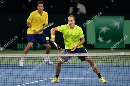 Stock Image of Brazil's Marcelo Melo (l) and Bruno Soares in Action Against Germany's Martin Emmrich and Daniel Brands During During the Davis Cup World Group Playoff Match Between Germany and Brazil at Ratiopharm Arena in Neu Ulm Germany 14 September 2013 Germany Neu-ulm
