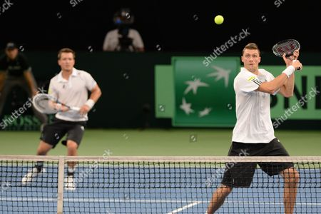 Stock Picture of Germany's Martin Emmrich (l) and Daniel Brands in Actio Against Brazil's Marcelo Melo and Bruno Soares During the Davis Cup World Group Playoff Match Between Germany and Brazil at Ratiopharm Arena in Neu Ulm Germany 14 September 2013 Germany Neu-ulm