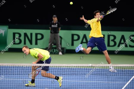 Stock Photo of Brazil's Marcelo Melo (l) and Bruno Soares in Action Against Germany's Martin Emmrich and Daniel Brands During During the Davis Cup World Group Playoff Match Between Germany and Brazil at Ratiopharm Arena in Neu Ulm Germany 14 September 2013 Germany Neu-ulm