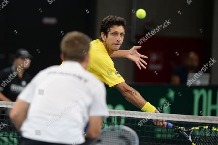 Brazil's Marcelo Melo (r) in Action Against Germany's Martin Emmrich and Daniel Brands During During the Davis Cup World Group Playoff Match Between Germany and Brazil at Ratiopharm Arena in Neu Ulm Germany 14 September 2013 Germany Neu-ulm