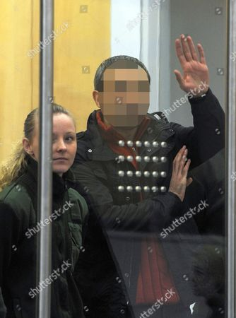 Defendant Unal Kaplan D Stands Stands Next to a Judicial Officer at the Regional Appeal Court and Waves to the Audience in Duesseldorf Germany 09 February 2012 Sadi Naci O and One Other Defendant Are Accused of Participating and Directing a Foreign Terrorist Organisation the Sentencing Against Members of the Left-wing Terrorist Organisation Dhkp-c Responsible For Attacks in Turkey is Expected to Be Announced on 09 February 2012 Germany Duesseldorf