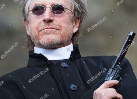 Actor Martin Semmelrogge Poses with a Revolver During the Presentation of the New Production of Karl May's Among Vultures at the Natural Open Air Stage in Elspe Germany 04 February 2014 the Production Will Premiere on 14 June 2014 As Part of the Annual Karl-may-festival Germany Elspe