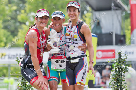 Triathletes Caroline Steffen of Switzerland (l-r 3rd Place) Mirinda Carfrae of Australia (1st Place) and Rachel Joyce of Britain (2nd Place) Celebrate on the Podium After the Datev Challenge Roth Triathlon Competition Inároth Germany 20 July 2014 Germany Hilpoltstein