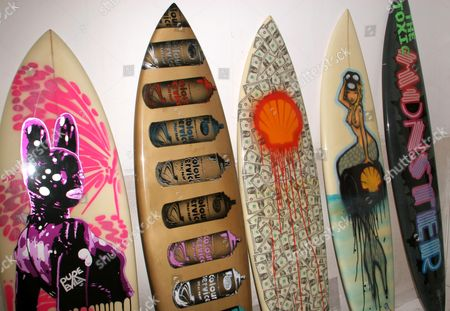 Surfboards designed by various Urban Artists