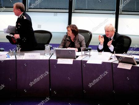 Metropolitan Police Commissioner Sir Ian Blair leaves the Metropolitan Police Authority meeting as Mayor of London Boris Johnson applauds and Catherine Crawford, MPA Chief Executive (centre), looks on.