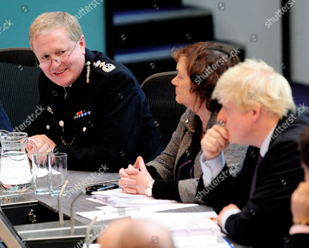 Metropolitan Police Commissioner Sir Ian Blair speaks at the Metropolitan Police Authority meeting as Mayor of London Boris Johnson (R) and Catherine Crawford, MPA Chief Executive (centre), listen.