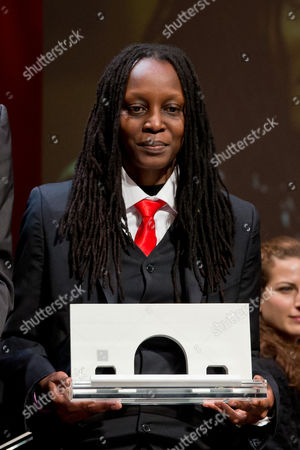 Ugandan Human Rights Activist Kasha Jacqueline Nabagesera Holds Her Award During the Awarding Ceremony of the International Nuremberg Human Rights Prize in Nuremberg Germany 29 September 2013 the City Honors the Iniatitive of the 33-year-old Activist in Defending and Promoting the Rights of Gays Lesbians and Bisexuals That Face Threats and Violence in Her Homeland Uganda Germany Nuremberg