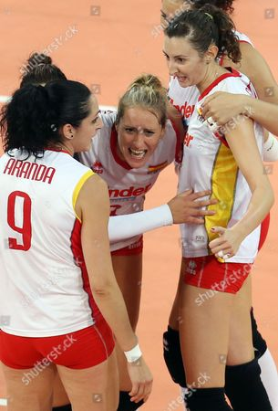 Stock Photo of Patricia Aranda Munoz (l-r) Diana Sanchez and Rocio Gomez Lopez of Spain Celebrate During Their Women's Cev Volleyball European Championship Group a Match Between Spain and Turkey at Gerry Weber Stadium in Halle/westphalia Germany 07 September 2013 Germany Halle