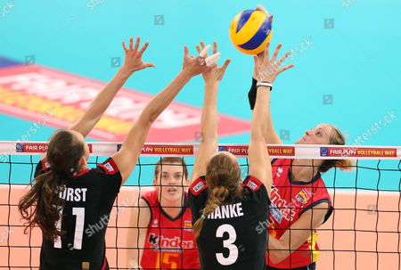 Christiane Fuerst (l) and Denise Hanke (2nd From Right) of Germany in Action Against Mireya Delgado Garcia (2nd From Left) and Diana Sanchez (r) of Spain During Their Women's Cev Volleyball European Championship Group a Match Between Germany and Spain at Gerry Weber Stadium in Halle/westphalia Germany 06 September 2013 Germany Halle