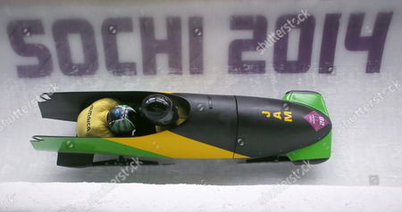 Pilot Winston Watts and Marvin Dixon of Jamaica Team 1 Compete in the Two-man Heat 3 Bobsleigh Event in Sliding Center Sanki at the Sochi 2014 Olympic Games Krasnaya Polyana Russia 17 February 2014 Russian Federation Krasnaya Polyana