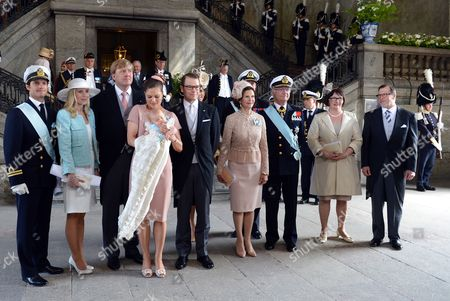 Crown Princess Victoria of Sweden (4-l) and Prince Daniel (5-l) with Their Daughter Princess Estelle Pose with Family Members and Godparents (l-r) Swedish Prince Carl Philip Anna Westling Blom Dutch Crown Prince Willem-alexander Sweden's Queen Silvia King Carl Xvi Gustaf and Ewa and Olle Westling After the Christening of Princess Estelle at the Royal Chapel (slottskyrkan) in Stockholm Sweden 22 May 2012 Princess Estelle was Born on 23 February 2012 Sweden Stockholm