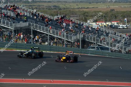 German Formula One Driver Sebastian Vettel (r) of Red Bull and Russian Vitaly Petrov of Caterham Steer Their Cars During the First Practice Session at the Circuit of the Americas in Austin Texas Usa 16 November 2012 the Formula One United States Grand Prix Will Take Place on 18 November 2012 United States Austin