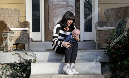 """Rachel Potter, Jude Potter Rachel Potter holds her son, Jude, at their home in Nashville, Tenn. Potter, a Nashville-based singer who has toured the country as part of the cast of the hit musical """"Wicked"""" as well as performing gigs with her country music band Steel Union, said she couldn't afford insurance before the Affordable Care Act. From a return to higher premiums based on female gender, to gaps in coverage for breast pumps used by nursing mothers, President Donald Trump's vow to repeal his predecessor's health care law is raising concerns about the impact on women's health"""