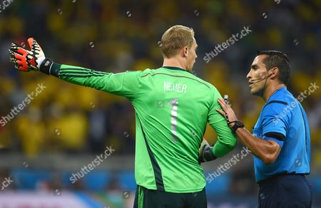German Goalkeeper Manuel Neuer (l) Argues with Referee Marco Rodriguez (r) of Mexico During the Fifa World Cup 2014 Semi Final Match Between Brazil and Germany at the Estadio Mineirao in Belo Horizonte Brazil 08 July 2014 Germany Won 7-1 (restrictions Apply: Editorial Use Only not Used in Association with Any Commercial Entity - Images Must not Be Used in Any Form of Alert Service Or Push Service of Any Kind Including Via Mobile Alert Services Downloads to Mobile Devices Or Mms Messaging - Images Must Appear As Still Images and Must not Emulate Match Action Video Footage - No Alteration is Made to and No Text Or Image is Superimposed Over Any Published Image Which: (a) Intentionally Obscures Or Removes a Sponsor Identification Image; Or (b) Adds Or Overlays the Commercial Identification of Any Third Party Which is not Officially Associated with the Fifa World Cup) Brazil Belo Horizonte