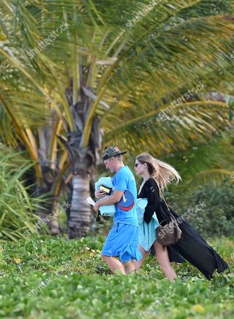 Bastian Schweinsteiger of the German National Soccer Team and His Girlfriend Sarah Brandner Go For a Walk on the Beach in Front of the Team Hotel in Santo Andre Brazil 05 July 2014 Brazil Santo Andre