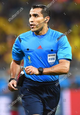 Referee Marco Rodriguez of Mexico Reacts During the Fifa World Cup 2014 Semi Final Match Between Brazil and Germany at the Estadio Mineirao in Belo Horizonte Brazil 08 July 2014 Germany Won 7-1 (restrictions Apply: Editorial Use Only not Used in Association with Any Commercial Entity - Images Must not Be Used in Any Form of Alert Service Or Push Service of Any Kind Including Via Mobile Alert Services Downloads to Mobile Devices Or Mms Messaging - Images Must Appear As Still Images and Must not Emulate Match Action Video Footage - No Alteration is Made to and No Text Or Image is Superimposed Over Any Published Image Which: (a) Intentionally Obscures Or Removes a Sponsor Identification Image; Or (b) Adds Or Overlays the Commercial Identification of Any Third Party Which is not Officially Associated with the Fifa World Cup) Brazil Belo Horizonte