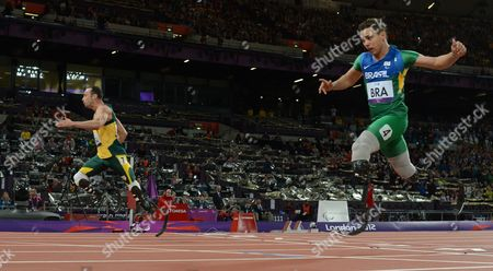 Oscar Pistorius (l) of South Africa Crosses the Finish Line Ahead of Alan Fonteles Cardoso Oliveira of Brazil (r) to Secure the Gold Medal For the South Africa Relay Team Along with Samkelo Radebe Zivan Smit Arnu Fourie (all Unseen) in the Men's 4x100m Relay -t42-46 Final at Olympic Stadium During the London 2012 Paralympic Games London Britain 05 September 2012 United Kingdom London