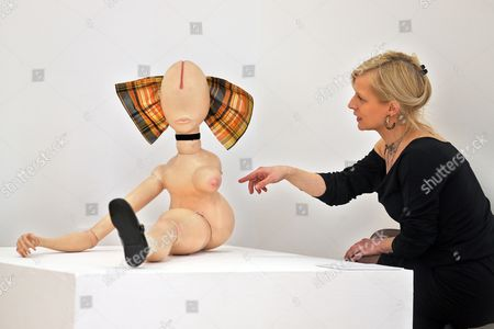 Stock Picture of Aámember of the Kunstverein Art Association Points to the Puppet 'La Demi-poupee' (1971) by German Artist Hans Bellmer During a Press Meeting For the Exhibition 'Puppets in the Classic Modern' at the Kunstverein Talstrasse E V in Halle/saale Germany 22 April 2014 the Exhibition Kicks Off on the Opening Weekend of the New Arts Hall of the Kunstverein a 360 Square Meters Large Extension Building That Cost 1 5 Million Euros From 25 to 27 April Germany Halle