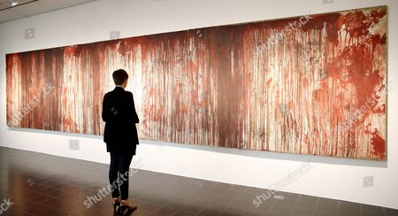 A Visitor Stands in Front of the Paintingá'untitled (kreuzbluttriptychon 1)' by Austrian Artist Hermann Nitsch at the 'Kunsthalle' Ináhamburg ágermany 31 July 2014 the Hamburg Kunsthalle is Remaining Open Despite Modernization Works Some 200 Masterpieces From the Museum's Permanent Collection Will Be on Display Under the Title 'Spot On' at the Kunsthalle's 'Galerie Der Gegenwart' (galery of Contemporary Art) Until 03 January 2016 Germany Hamburg