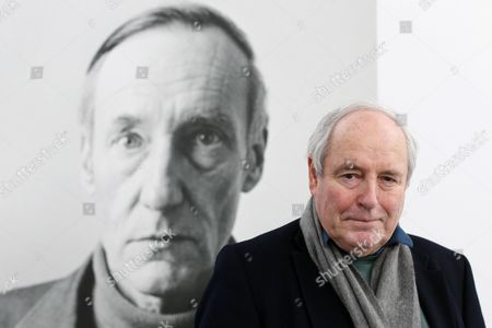 Curator Harald Falckenberg Poses in Front of a Portrait of Us Writer and Artist William S Burroughs After a Press Conference on the Exhibition 'William S Burroughs Retrospective' at Deichtorhallen Collection Falckenberg in Harburg Near Hamburg Germany 15 March 2013 the Exhibition Opens to the Public From 16 March to 18 August Germany Harburg