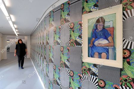 Stock Picture of An Employee of the Kunsthalle Worpswede Walks Past a Wallpaper Designed by German Artist Josephine Meckseper at the Kunsthalle Art Space in Worpswede Germany 01 November 2012 a Painting (r) by Worpsweden Artist Heinrich Vogeler is on Display on the Wall the Mixed Media Installation is Part of the Exhibition 'Contemporary Worpswede' Featured Between 03 November 2012 and 27 January 2013 Germany Worpswede