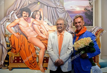 German Fashion Designer Wolfgang Joop (r) and Us Pop Art Artist Mel Ramos (l) Smile Next to His Work 'David's Duo'at the Fine Arts Museum (museum Der Bildenden Kuenste) in Leipzig Germany 12 October 2013 the Exhibition 'Beauty and the Beast - Richard Mueller & Mel Ramos & Wolfgang Joop' is on Display From 13 October 2013 to 12 January 2014 Germany Leipzig
