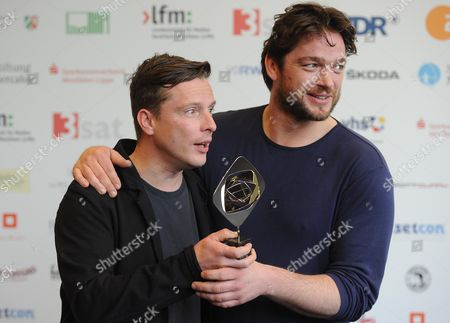 Actors Florian Panzner (l) and Ronald Zehrfeld (r) Pose with the Award in the 'Fiction' Category For the Tv Movie 'Mord in Eberswalde' (wdr) Before the Award Ceremony For the Grimme Awards (grimme-preis) 2014 in Marl Germany 04 April 2014 Germany Cologne