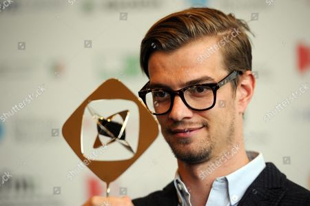 German Host Joko Winterscheidt Poses For Photographs with the Award in the 'Entertainment' Category Before the Award Ceremony For the Grimme Awards (grimme-preis) 2014 in Marl Germany 04 April 2014 Germany Cologne