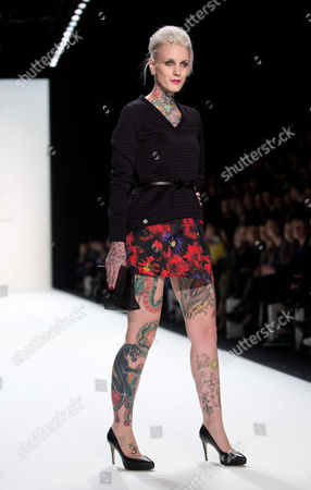 Austrian-born Tattoo Model Lexy Hell Presents a Creation by German Designer Anja Gockel During the Mercedes-benz Fashion Week in Berlin Germany 16 January 2013 the Presentations of the Fall-winter 2013/2014 Collections Takes Place at the Mercedes-benz Fashion Week Berlin From 15 to 18 January Germany Berlin