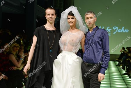 Stock Image of German Designers Niklas Kauffeld (l) and Matthias Jahn (r) Flank German Model Micaela Schaefer Presenting a Creation by Their Fashion Label Kauffeld and Jahn Couture at the Berlin Fashion Week in Berlin Germany 14 January 2014 the Fashion Event Will Present Fall/winter 2014/2015 Collections From 14 to 19 January Germany Berlin