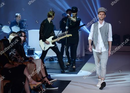 A Model Presents a Creation From the Spring/summer 2015 Collection of German Designer Esther Perbandt (2-r) who is Performing with a Band at the 'Michalsky Stylenite' at the Tempodrom During Mercedes-benzáfashion Week in Berlin ágermany 11 July 2014 the Event Runs From 08 to 11 July Germany Berlin