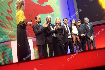Show Host Anke Engelke (l-r) and Jury Members Iranian Director Asghar Farhadi Algerian Author Boualem Sansal German Actress Barbara Sukowa French Director Francois Ozon French Actress Charlotte Gainsbourg Us Actor Jake Gyllenhaal Dutch Director Anton Corbijn and Jury President Mike Leigh Onstage During the Opening Gala of the 62nd Berlin International Film Festival in Berlin Germany 09 February 2012 the Movie 'Farewell My Queen (les Adieux a La Reine)' Has Been Selected As the Festival's Opening Film and is Part of the Main Competition the the 62nd Berlinale Takes Place From 09 to 19 February Germany Berlin