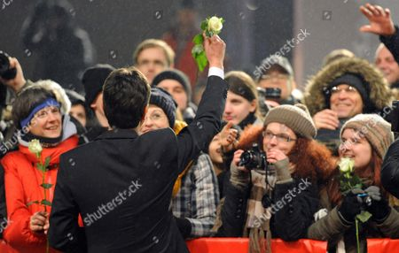 Portuguese Director Miguel Gomes Gives Roses to the Audience As He Arrives For the Premiere of His Movie 'Tabu' During the 62nd Berlin International Film Festival in Berlin Germany 14 February 2012 the Movie is Presented in Competition at the 62nd Berlinale That Runs From 09 to 19 February Germany Berlin