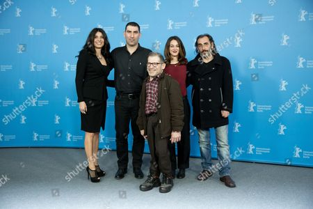 Stock Photo of (l-r) Greek Actress Popi Tsapanidou Director Yannis Economides and Actors Petros Zervos Vicky Papadopoulou and Vangelis Mourikis Pose During the Photocall For 'To Mikro Psari (stratos)' During the 64th Annual Berlin Film Festival in Berlin Germany 11 February 2014 the Movie is Presented in the Official Competition of the Berlinale Which Runs From 06 to 16 February 2014 Germany Berlin