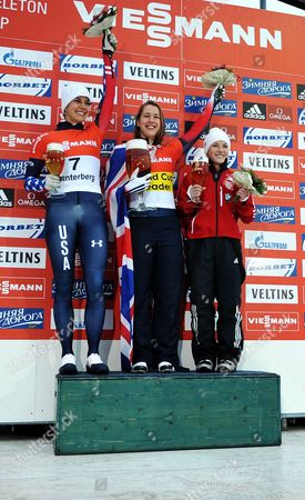 Usa's Second-placed Noelle Pikus-pace (l-r) Winner Elizabeth Yarnold of Britain and Third-placed Sarah Reid of Canada Cheer on the Podium at the Skeleton World Cup in Winterberg ágermany 04 January 2014 Germany Winterberg