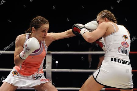 German Boxer Ina Menzer (l) in Action Against German Boxer Goda Dailydaite at the Hockey Park in Moenchengladbach Germany 24 August 2013 Menzer Won the Fight by Unanimous Decision Thus Winning the World Title of the World Federation Wbf Featherweight and Also Secured the Interim Championships Wibf and Wib Germany Moenchengladbach
