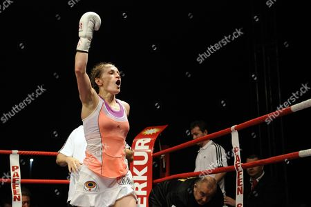 German Boxer Ina Menzer Celebrates After Her Fight Against German Boxer Goda Dailydaite at the Hockey Park in Moenchengladbach Germany 24 August 2013 Menzer Won the Fight by Unanimous Decision Thus Winning the World Title of the World Federation Wbf Featherweight and Also Secured the Interim Championships Wibf and Wib Germany Moenchengladbach