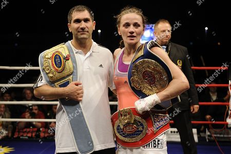 German Boxer Ina Menzer Poses with Her Coarch Michael Timm After Her Fight Against German Boxer Goda Dailydaite at the Hockey Park in Moenchengladbach Germany 24 August 2013 Menzer Won the Fight by Unanimous Decision Thus Winning the World Title of the World Federation Wbf Featherweight and Also Secured the Interim Championships Wibf and Wib Germany Moenchengladbach