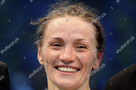 German Boxer Ina Menzer Smiles After Her Fight Against German Boxer Goda Dailydaite at the Hockey Park in Moenchengladbach Germany 24 August 2013 Menzer Won the Fight by Unanimous Decision Thus Winning the World Title of the World Federation Wbf Featherweight and Also Secured the Interim Championships Wibf and Wib Germany Moenchengladbach