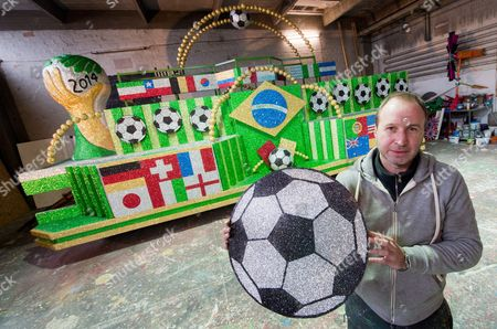 Artist and Float Builder Torsten Koch Stands in Front of His Carnival Float with the World Cup 2014 in Brazil As Theme in Brunswick Germany 13 February 2014 the Carnival Parade in the North German Carnival Stronghold Will Take Place on 02 March Germany Brunswick