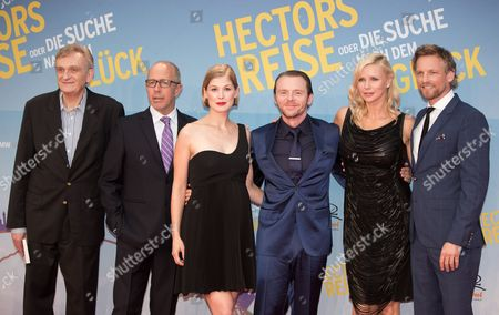 (l-r) French Psychiatrist and Writer Francois Lelord British Director Peter Chelsom British Actors Rosamund Pike and Simon Pegg German Actress Veronica Ferres and Dutch Actor Barry Atsma Arrive For the Premiere of 'Hector and the Search For Happiness' at the Zoo-palast in Berlin Germany 05 August 2014 the Movie Opens in German Theaters on 14 August Germany Berlin