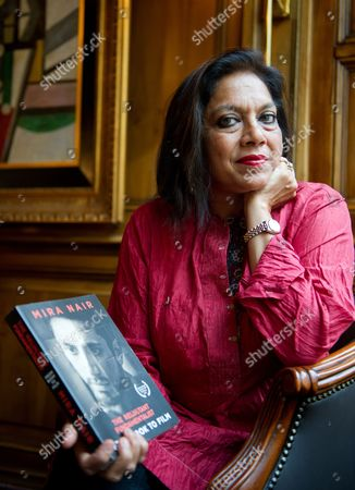 Indian Director Mira Nair Holds a Copy of Her Book 'The Reluctant Fundamentalist: From Book to Film' During an Interview in Munich Germany 03 July 2013 Nair Received the German Cinema Award For Peace For Her Film Adaptation of the Novel 'The Reluctant Fundamentalist' by Pakistani Writer Mohsin Hamid That She is Also Presenting at the Munich Film Festival Germany Munich