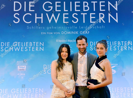 From (l-r) German Actors/cast Members Hannah Herzsprung Florian Stetter and Henriette Confurius Pose with German Director Dominik Graf (2-l) As They Arrive For the Movie Premiere 'The Beloved Sisters' in Weimar (thuringia) Germany 23 July 2014 Germany Weimar