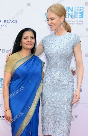 Stock Picture of Deputy Executive Director of Un Women Lakshmi Puri (l) and Australian Actress Nicole Kidman Arrives For the Cinema For Peace Gala Dinner at Soho House in Berlin Germany 12 July 2013 the Cinema For Peace Foundation Will Honor the Organization Un Women and Its Goodwill Ambassador Nicole Kidman at the Gala Dinner Germany Berlin