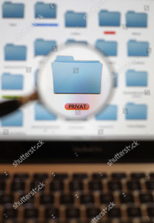 An Illusrtartion Dated 01 July 2013 Shows a Folder Icon on a Computer Screen Saying 'Private' (privat) Viewed Through a Magnifying Glass Kaufbeuren Germany German Chancellor Angela Merkel's Government Condemned 01 July Reports of Spying by Us Intelligence Agencies Upon Eu Offices with Her Spokesman Saying It was Unacceptable and Calling For Trust to Be Restored 'Spying on Your Friends is Unacceptable It Can't Happen ' Merkel's Spokesman Steffen Seibert Told a Regular Press Briefing in Berlin 'We Are No Longer in the Cold War ' 'Europe and the Us Are Partners Friends and Allies ' He Said the German Foreign Office Has Called the Us Ambassador to Germany Philip D Murphy to the Ministry For Consultation on the Issue Germany Kaufbeuren