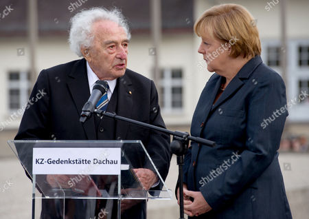 German Chancellor Angela Merkel (r) and Holocaust Survivor Max Mannheimer (l) Talk As She Visits the Concentration Camp Memorial in Dachau Germany 20 August 2013 Merkel is the First German Incumbent Head of Government to Visit the Concentration Camp Yet Her Visit to the Memorial Has Sparked Controversy She Visited the Concentration Camp Quickly Between Two Other Election Campaign Events in Erlangen and Dachau the German Federal Elections Will Be Held on 22 September 2013 Germany Dachau