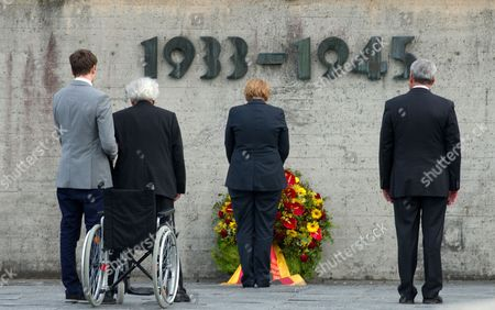 German Chancellor Angela Merkel (c) Bavarian Culture Minister Ludwig Spaenle (r) and Holocaust Survivor Max Mannheimer (2-l) Lay a Wreath at the Concentration Camp Memorial in Dachau Germany 20 August 2013 Merkel's Visit to the Memorial Has Sparked Controversy She Visited the Concentration Camp Quickly Between Two Other Election Campaign Events in Erlangen and Dachau the German Federal Elections Will Be Held on 22 September 2013 Germany Dachau